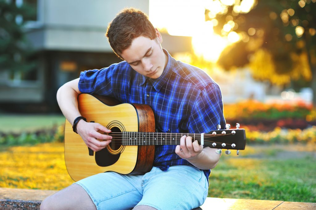 Holding a guitar